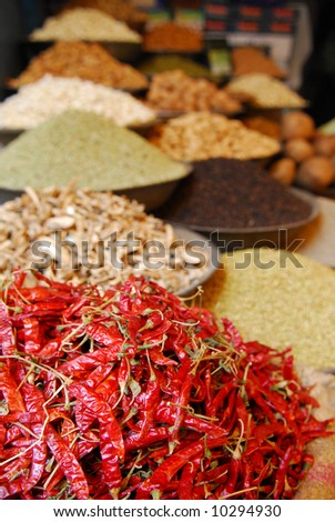 red hot chili peppers and other spices on indian market