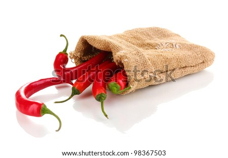 Red hot chili peppers in bag isolated on white