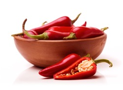 Red Hot Chili Peppers in bowl on white background