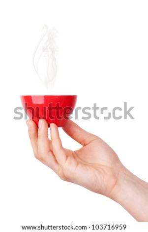 Red hot cup of coffee in hand on white background