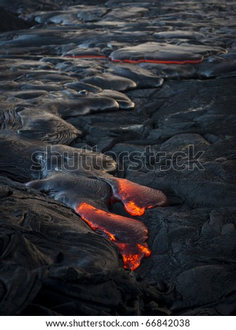 Red hot flowing lava