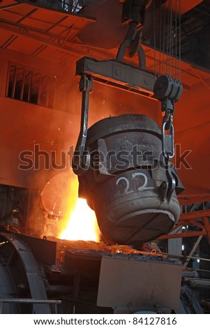 red-hot molten steel in a iron and steel enterprise production scene