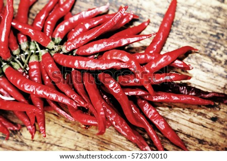 red hot peppers on wooden table ...