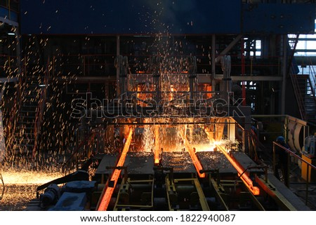 Red hot steel metal billets after molten steel casting.  Continuous casting machine. Background of the blacksmith and metallurgical industry. Foto stock ©