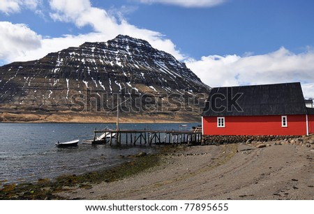 Red House In Deep Fjord, East Fjords, Iceland Stock Photo 77895655