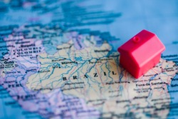 Red house on Brazil part of world map. Real estate in/ citizenship of Brazil concept.