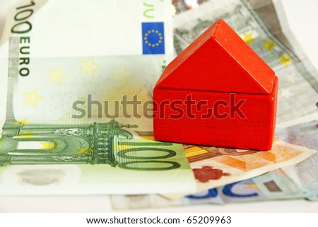Red house on euro money, household and financing concept