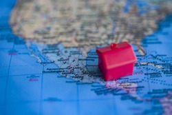 Red house on Mexico part of world map. Real estate / citizenship/ immigration in Mexico concept.