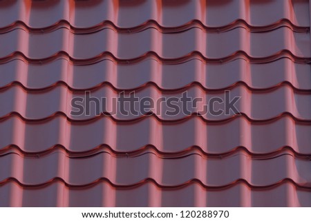Red house roof as background closeup - stock photo