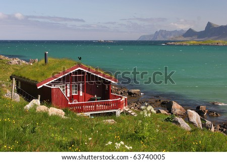 Red house with grass roof