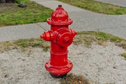 Red hydrant fire detail prevention system with green out of focus wood in background