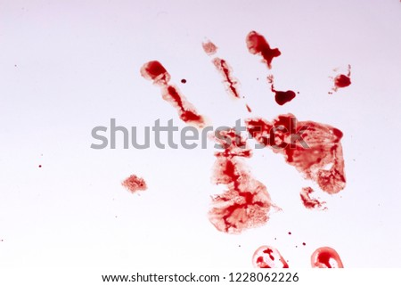 Red imprint of the bloody palm on a white background #1228062226