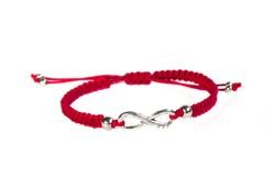 red infinity bracelet handmade on white background, hand decoration