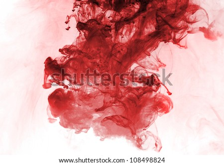 Red ink in water on a white background.