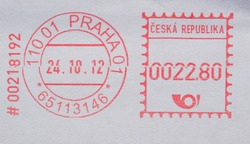red ink postage meter from Prague over white envelope