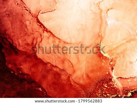 Photo of  Red ink water. Marble texture. Hot volcanic lava abstract design with streak pattern. Bright glitter fluid with orange golden fleck grain. Creative stained surface art background. Mars planet.