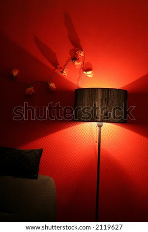 red interior ambiance with light sofa and pillow