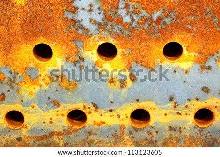 Red iron rust holes.