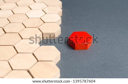 Red item is disconnected from other items. Hexagons. The concept of separating parts from a whole or connecting parts to a whole. Business process, logical structure, perfectionism. Creating new.