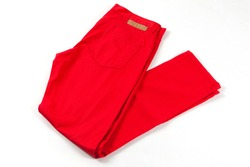 Red jeans pants isolated on white background. Folded casual style trousers