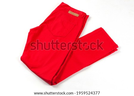 Red jeans pants isolated on white background. Folded casual style trousers  Stockfoto ©