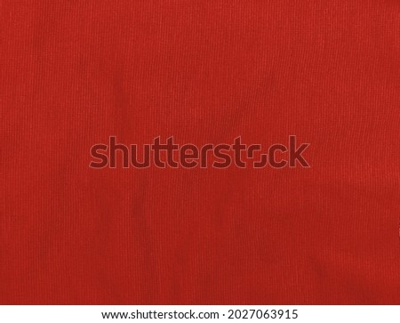 Red jersey fabric matte texture top view. Vinous knitwear background. Fashion color trendy clothes. Website backdrop text sign design. Abstract burgundy wallpaper luxurious textile surface. Foto d'archivio ©