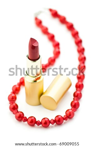 red jewelry and lipstick on white