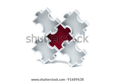Red jigsaw puzzle interlocked with white pieces