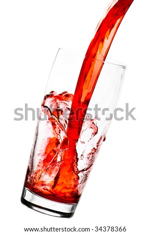 Red juice in glass with splashes - isolated on white