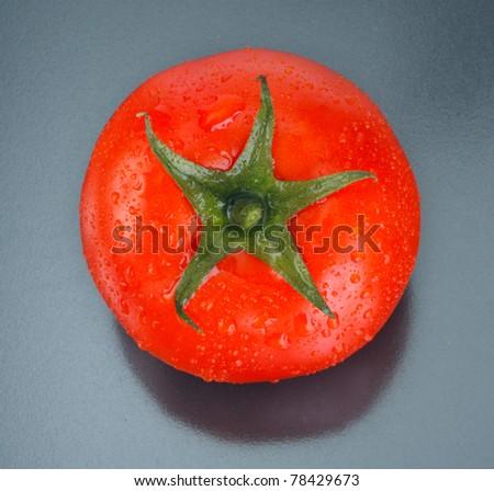 Red juicy tomato .