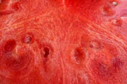 red juicy watermelon in the context of close . the texture of the watermelon
