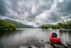 Red Kayak at Llyn Padarn lake, Snowdonia, Wales, UK