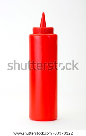 Red Ketchup dispenser isolated on white background - stock photo
