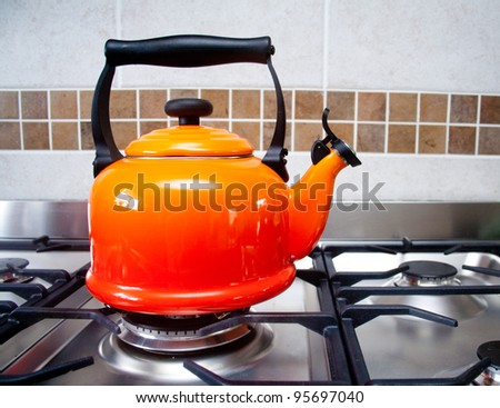Red kettle on a gas stove