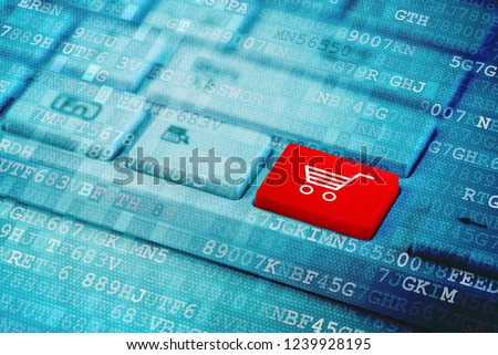 d01aadfdd84 Red key with Shopping cart icon symbol on blue digital laptop keyboard.   1239928195