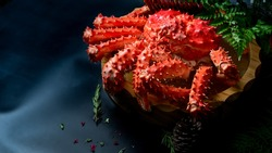 Red King Crab Japanese food on black table, selective focus.