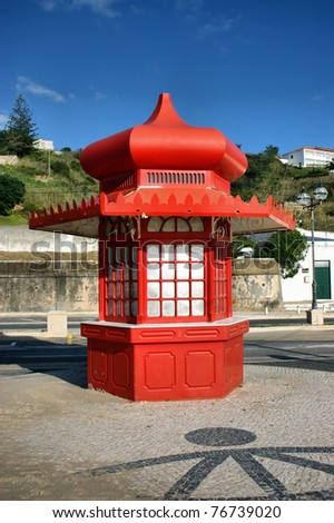 Red kiosk in Foz do Arelho, Portugal