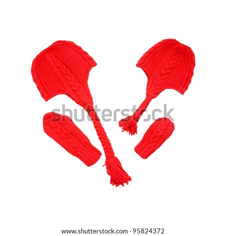 Red knitted hats and mittens, which are identical to the mother and daughter. Hand-made, isolated on white background with clipping path