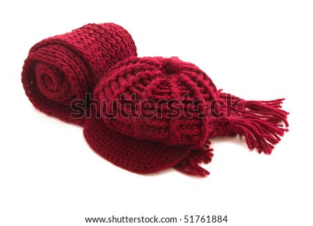 Red knitted  wool scarf and cap isolated on white