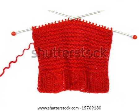 Red knitting on white background .