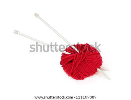 Red knitting wool and needles over white background - stock photo