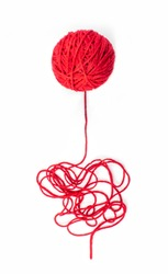 Red knitting yarn for handicrafts isolated on white background