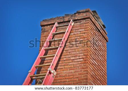 Red Ladder Against Old Chimney