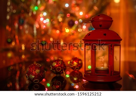 Red lantern and red christmas balls in christmas interior.