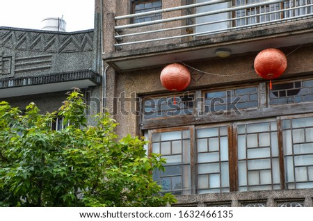 Red lantern hanging outside the ancient house.