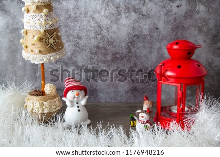 Red lantern, snowmen and Christmas tree