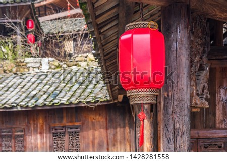Red lanterns hang from branches