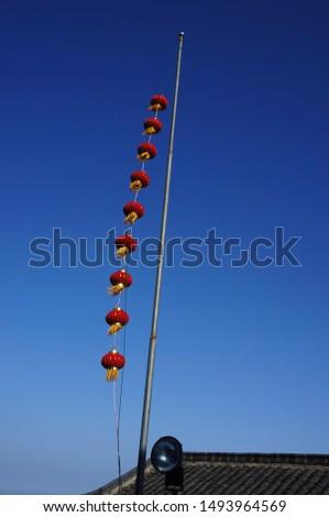 Red lanterns hang high in jiuhua mountain