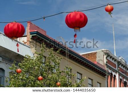 Red lanterns hanging  over Fisgard street in Chinatown, Victoria, British Columbia