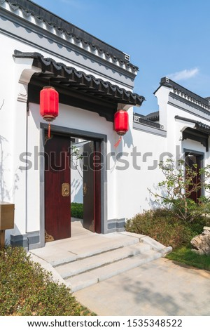 Red lanterns hung the gate house of Chinese style style #1535348522